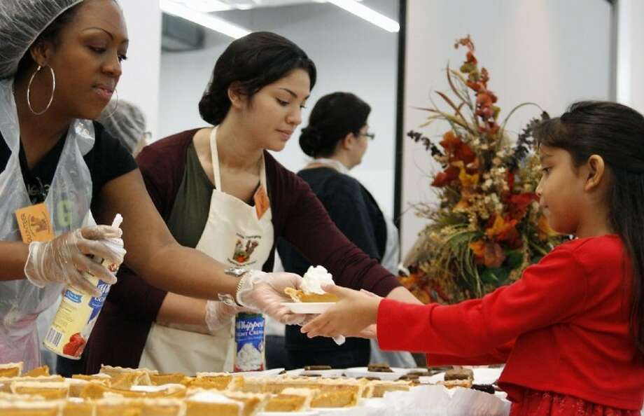 Volunteers gather at the Humble Civic Center each year to serve guests during the Humble Thanksgiving Feast. This year's event will be held Thanksgiving Day, Thursday, Nov. 24 from 11 a.m. - 2 p.m. Photo: Jennifer Summer