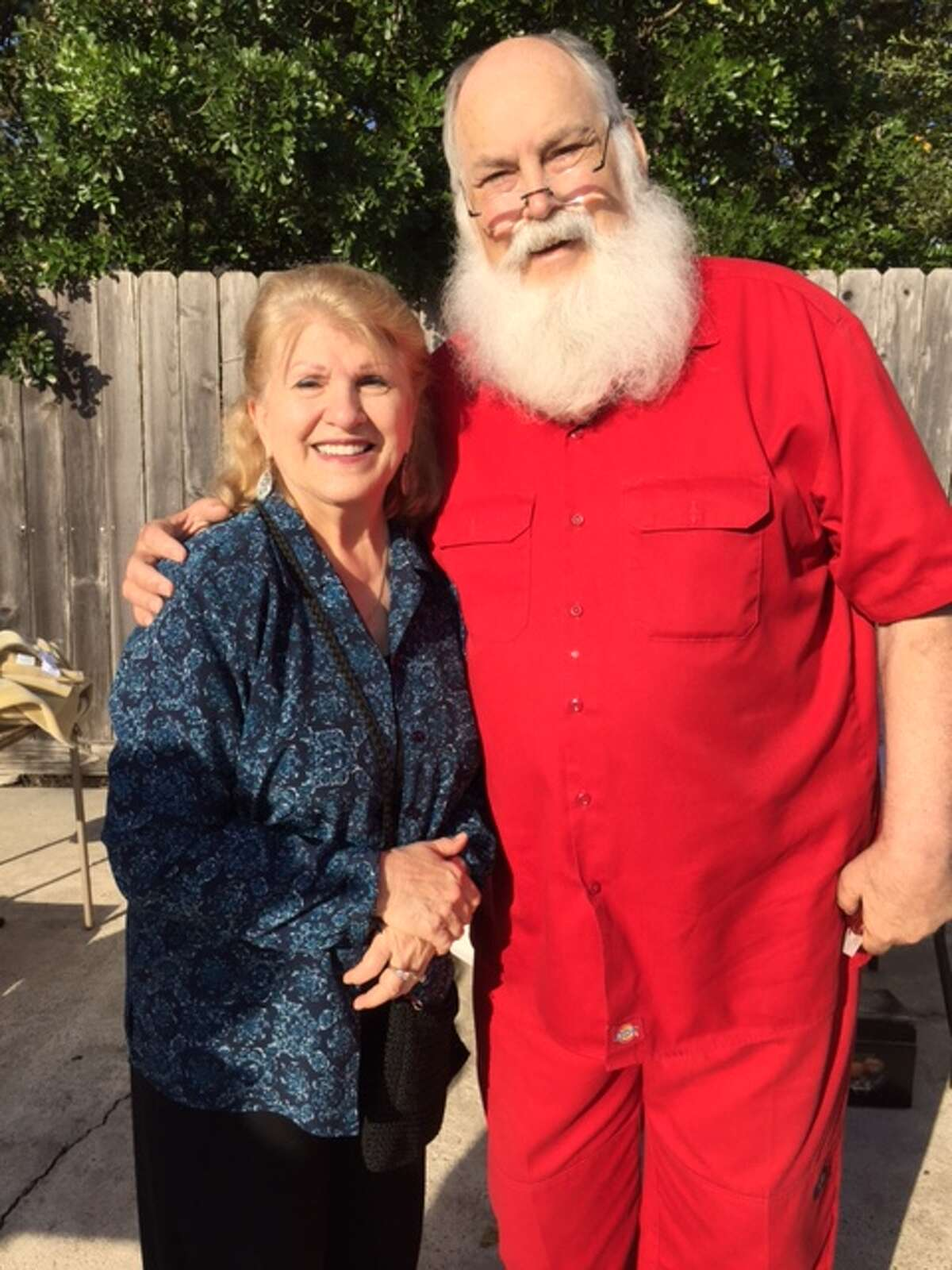 Santa Claus, pictured here with Marian Mannix, paid a surprise visit to the Lambda Delta Garage Sale held Saturday, Oct. 29.