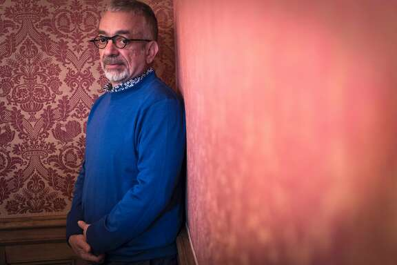 """Iranian writer Rabih Alameddine poses on October 25, 2016 after he was awarded with the Prix Femina literary prize for a foreign novel """"Les Vies de Papiers"""" (The Paper Lives) in Paris.  / AFP PHOTO / LIONEL BONAVENTURELIONEL BONAVENTURE/AFP/Getty Images"""