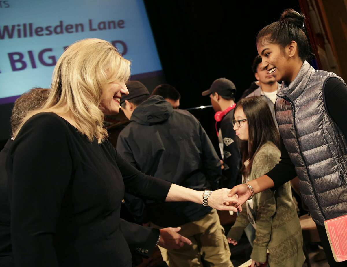 """Mona Golabek (left) greets Amritpal Kaur (right) , 15, of Arroyo High School, after Kaur and other students watched Golabek perform """"The Children of Willesden Lane"""" at the Herbst Theatre on Wednesday, November 9, 2016 in San Francisco, Calif. The performance is based on the book """"The Children of Willesden Lane"""" by Mona Golabek and Lee Cohen."""