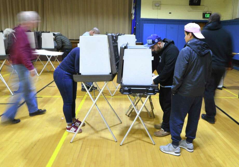 Voting on election day at Nathan Hale Middle School in Norwalk on Tuesday, Nov. 8. Photo: Alex Von Kleydorff / Hearst Connecticut Media / Connecticut Post