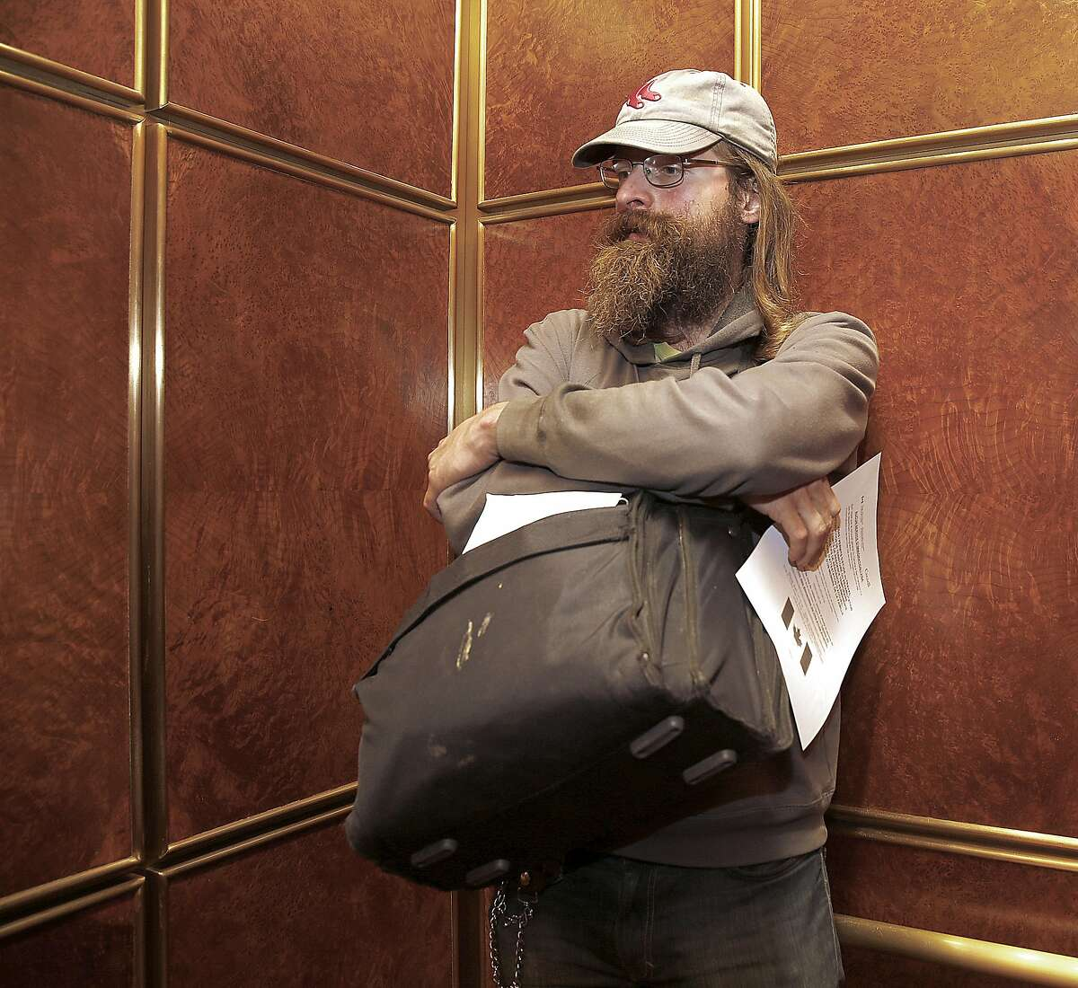 James Conrad goes to the Canada Consulate to ask for an immigration form on Wednesday, November 9, in San Francisco, Calif.