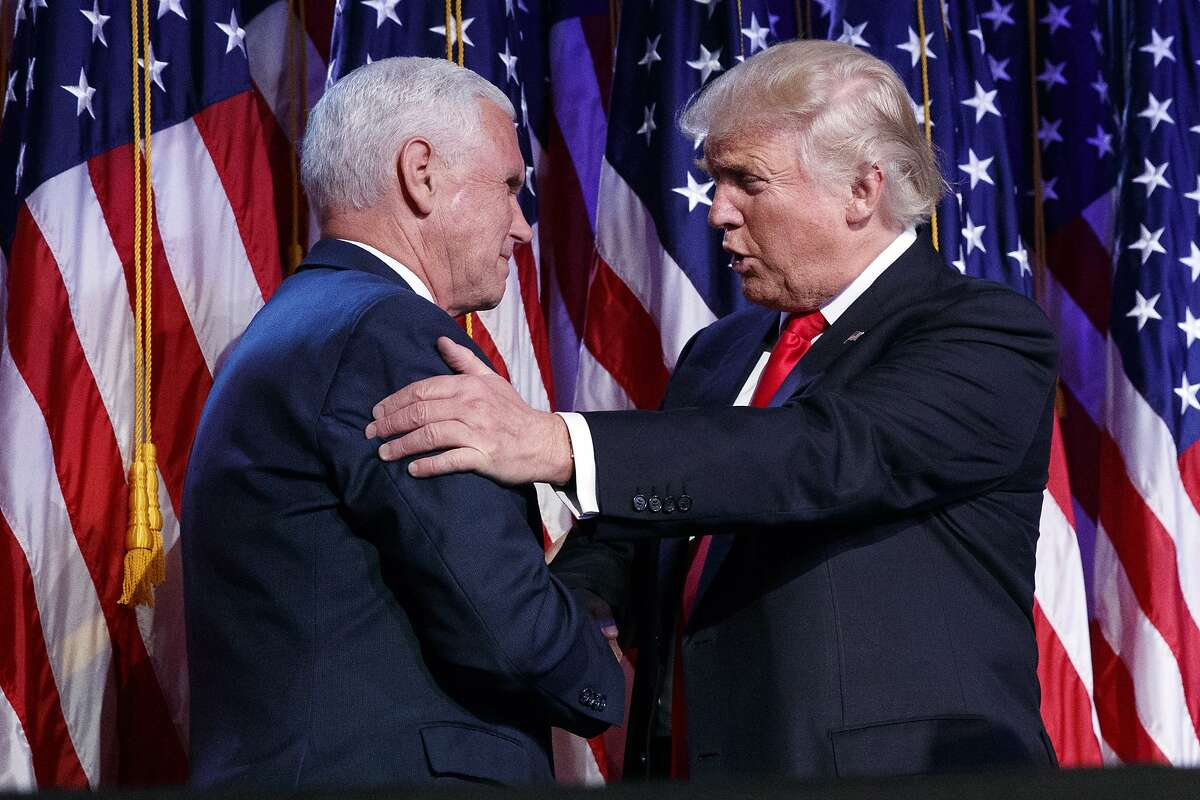 President-elect Donald Trump, right, shakes hands with vice president-elect Mike Pence during an election night rally, Wednesday, Nov. 9, 2016, in New York. (AP Photo/ Evan Vucci)