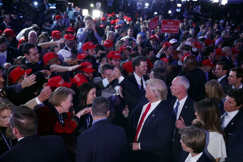 President-elect Donald Trump shakes hands during an election night rally, Wednesday, Nov. 9, 2016, in New York. (AP Photo/Evan Vucci) Photo: Evan Vucci, Associated Press