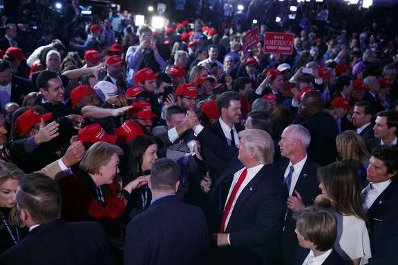 President-elect Donald Trump shakes hands during an election night rally, Wednesday, Nov. 9, 2016, in New York. (AP Photo/Evan Vucci)