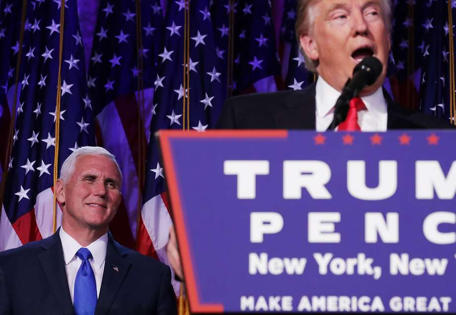 Republican president-elect Donald Trump delivers his acceptance speech as Vice president-elect Mike Pence looks on. Photo: Chip Somodevilla, Getty Images
