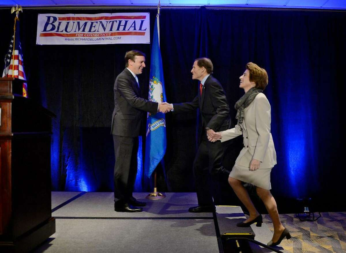 Sen. Richard Blumenthal and his wife, Cynthia, are introduced by Sen. Chris Murphy, left, at an election night rally Tuesday in Hartford.