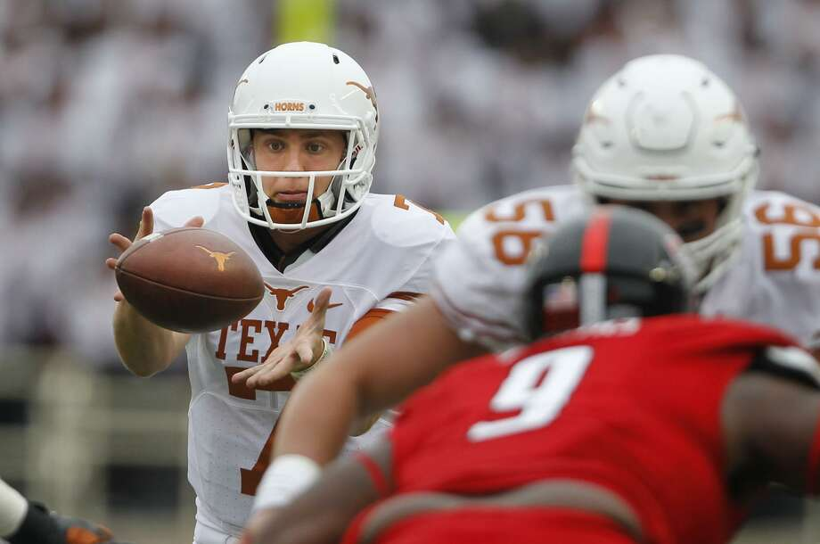 Texas quarterback Shane Buechele takes a snap in the first half against Texas Tech on Nov. 5, 2016, in Lubbock. Photo: Mark Rogers /Lubbock Avalanche-Journal / Lubbock Avalanche-Journal