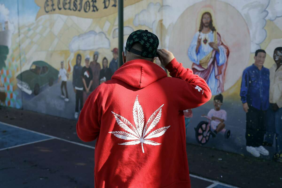 Armando Rodriguez, who smokes marijuana for recreational and medicinal purposes, wears a jacket with a marijuana leaf Wednesday, Nov. 9, 2016, in San Francisco. Prop 64 legalizing marijuana for recreational use passed in California. The number of Americans living in states with recreational marijuana more than tripled after at least three states voted to fully legalize the drug. (AP Photo/Marcio Jose Sanchez)