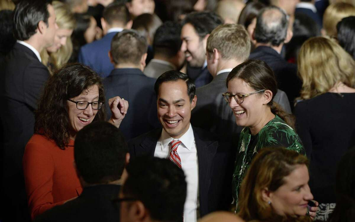 WASHINGTON, DC - OCTOBER 12: U.S. Department of Housing and Urban Development Secretary Julian Castro (C) attends a reception for Hispanic Heritage Month also attended by President Barack Obama in the East Room of the White House on October 12, 2016 in Washington, DC. The president praised gains made by Hispanics in education, income and health insurance during his administration. (Photo by Olivier Douliery-Pool/Getty Images)