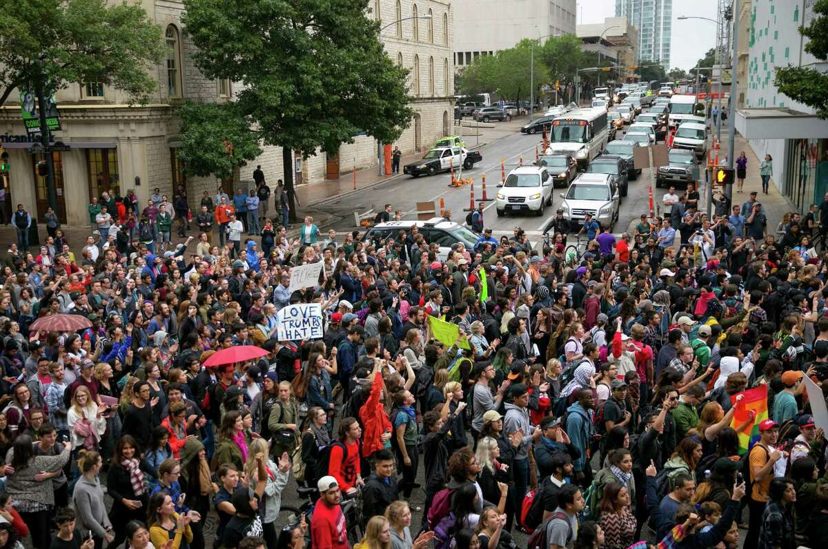 Anti-Trump protesters march along Congress Avenue in Austin, Texas, on Wednesday November 9, 2016. Hundreds of University of Texas students march through downtown Austin in protest of Donald Trump's presidential victory. (Jay Janner/Austin American-Statesman via AP)