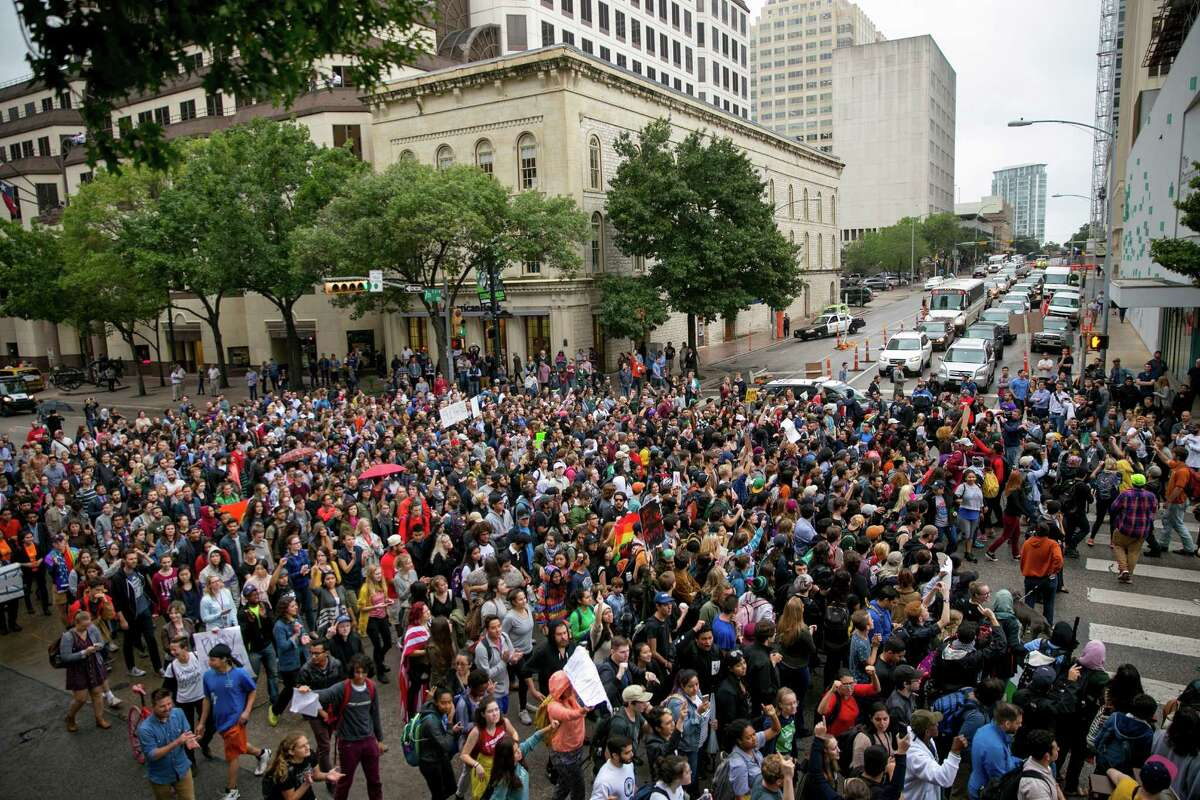 Anti-Trump protesters march along Congress Avenue in Austin, Texas, on Wednesday Nov. 9, 2016. Hundreds of University of Texas students march through downtown Austin in protest of Donald Trump's presidential victory. ( Jay Janner/Austin American-Statesman via AP)