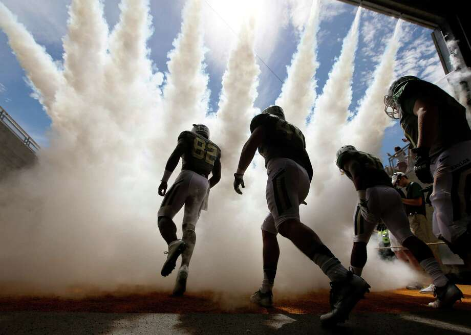 Baylor football players charge onto the field before an NCAA college football game against Southern Methodist University in Waco on Saturday, Sept. 10, 2016. (AP File Photo) Photo: LM Otero, STF / AP