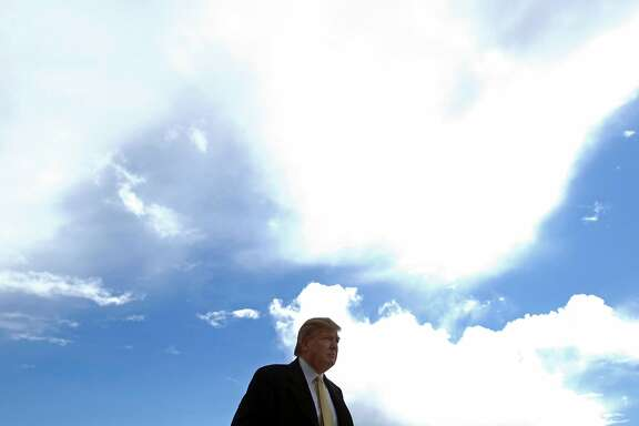 """(FILES) This file photo taken on May 27, 2010 shows US presidential nominee Donald Trump arriving to visit the construction site of his golf course on the Menie Estate near Aberdeen, Scotland.   Diplomats gather next week for a fresh round of UN climate talks in Marrakesh, but all eyes will be on America where presidential elections may be what determine the planet's future. Republican nominee Donald Trump, who has described global warming a """"hoax"""", said in May he would """"cancel"""" the climate-rescue Paris Agreement if elected leader of the free world. Should his threats be taken seriously? / AFP PHOTO / Derek BLAIRDEREK BLAIR/AFP/Getty Images"""