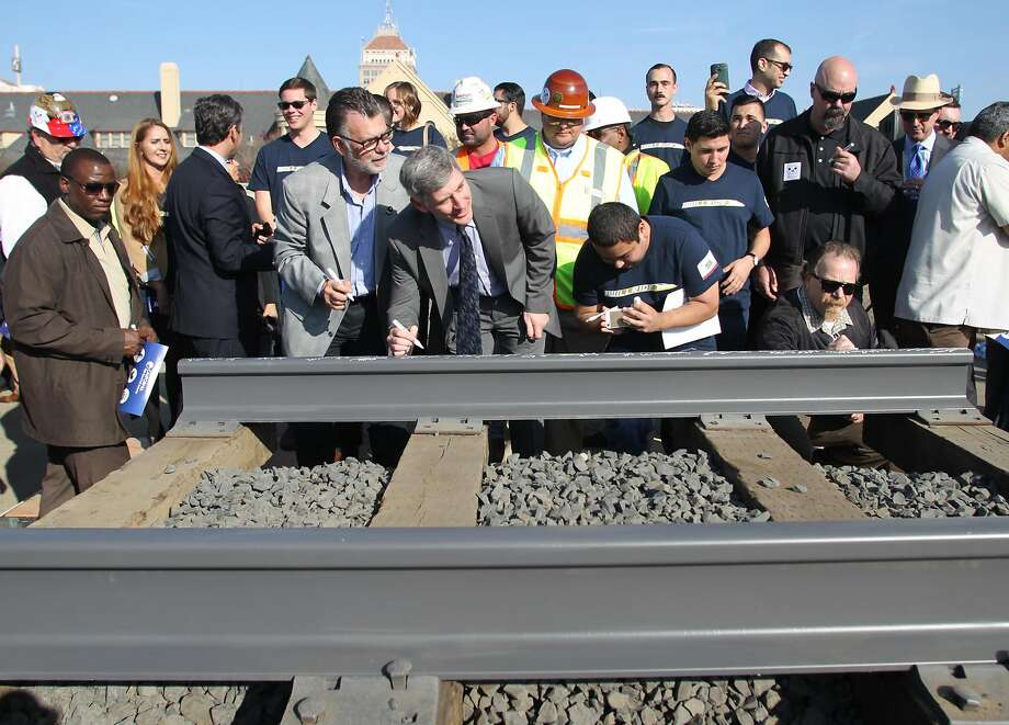 Dignitaries and VIP's line up to sign a portion of the rail at the California High Speed Rail Authority ground breaking event, Tuesday, Jan. 6, 2015 in Fresno, Calif. The $68 billion project faces challenges from Republicans in Congress eager to reduce government spending. The train would whisk travelers at 200 mph between Los Angeles and San Francisco in less than three hours. (AP Photo/Gary Kazanjian) Photo: Gary Kazanjian, Associated Press