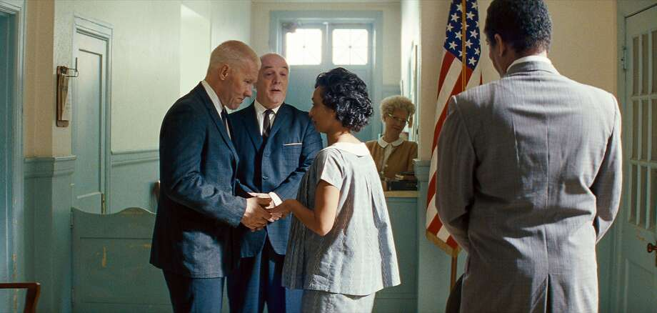 """This image released by Focus Features shows Ruth Negga, center right, and Joel Edgerton, left, in a scene from, """"Loving."""" (Travis Topa/Focus Features via AP) Photo: Travis Topa, Associated Press"""