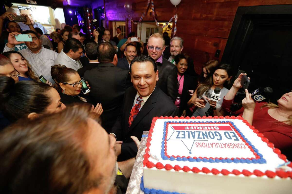 Ed Gonzalez and supporters celebrate with cake during an election watch party Tuesday night at Fitzgerald's.