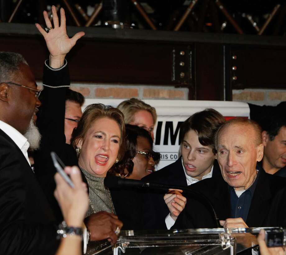 District attorney-elect Kim Ogg gives a victory speech Tuesday night at her election watch party at Ritual Restaurant. Appearing with her, from right, are her father, Jack Ogg, and her son, Jack Jordan. Photo: Melissa Phillip, Staff / Houston Chronicle 2016