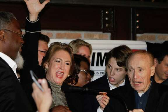 District attorney-elect Kim Ogg gives a victory speech Tuesday night at her election watch party at Ritual Restaurant. Appearing with her, from right, are her father, Jack Ogg, and her son, Jack Jordan.
