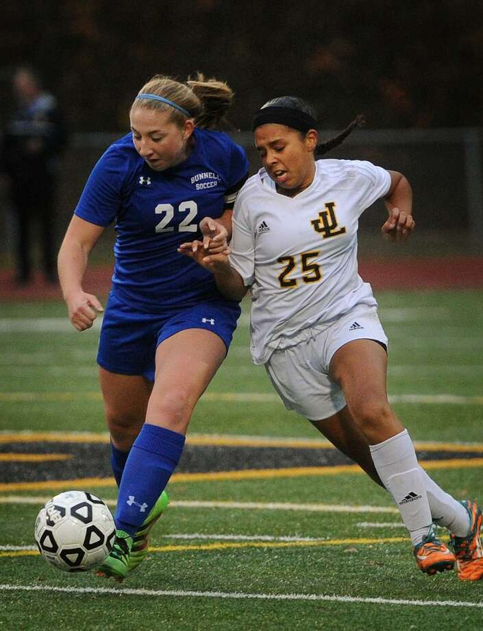 Bunnell's Emily Kratochwil, left, battles for the ball with Law's Ciana Lopes during the first round of the CIAC Class L State Girls Soccer Tournament at Jonathan Law High School in Milford, Conn. on Wednesday, November 9, 2016. Photo: Brian A. Pounds / Hearst Connecticut Media / Connecticut Post