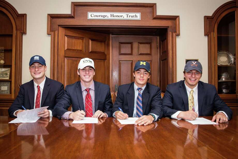 From left, Brunswick's Sean Morris (North Carolina), Spencer Decker (Vermont), Alex Buckanavage (Michigan) and John Fox (Virginia) signed their National Letters of Intent to play men's lacrosse on Wednesday. Photo: Contributed Photo / Greenwich Time Contributed