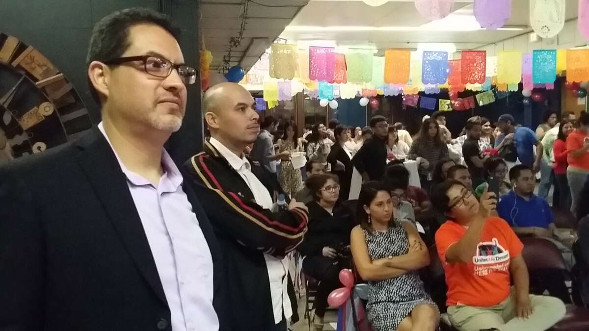 Carlos Duarte (left), Texas director of Mi Familia Vota, at a Latino 2016 election watch party on election day.