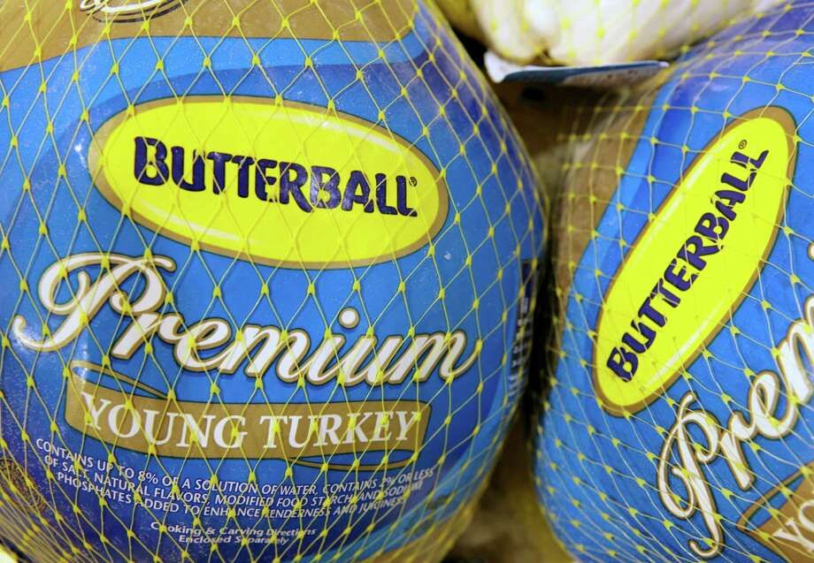 FILE - In this file photo made Dec. 7, 2009, Butterball frozen turkeys are on display at Heinen's grocery store in Bainbridge Township, Ohio. Butterball, which has been fielding phone calls from Thanksgiving cooks for more than 35 years, is letting people text their turkey-related questions this year for the first time. The company's regular phone help line begins Tuesday, Nov. 1, 2016. Butterball will start take text message questions on Nov. 17, 2016, and continue through Thanksgiving Day. (AP Photo/Amy Sancetta, File) ORG XMIT: NY120 Photo: Amy Sancetta / AP