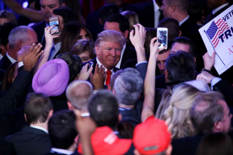 President-elect Donald Trump greets people in the crowd after delivering his acceptance speech at the New York Hilton Midtown in the early morning hours of November 9, 2016 in New York City. Photo: Mark Wilson, Getty Images