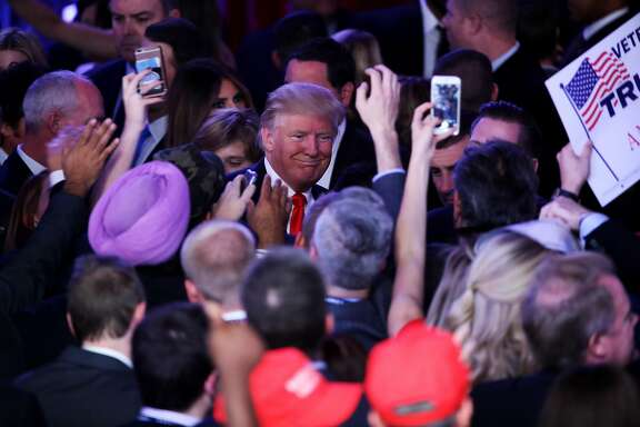 NEW YORK, NY - NOVEMBER 09:  Republican president-elect Donald Trump greets people in the crowd after delivering his acceptance speech at the New York Hilton Midtown in the early morning hours of November 9, 2016 in New York City. Donald Trump defeated Democratic presidential nominee Hillary Clinton to become the 45th president of the United States.  (Photo by Mark Wilson/Getty Images)