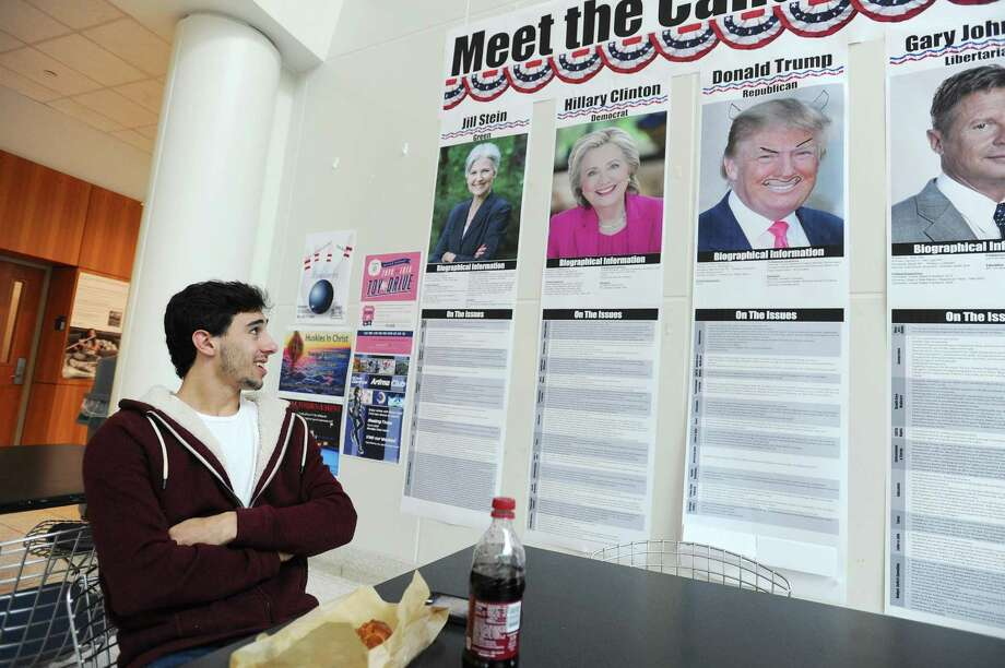 19-year-old Trump voter James Piniella, from Ridgefield, looks at UConn Stamford's wall of candidates while discussing the results of Tuesday's presidential election and his reasons for supporting the President-elect inside UConn Stamford in Stamford. Photo: Michael Cummo / Hearst Connecticut Media / Stamford Advocate