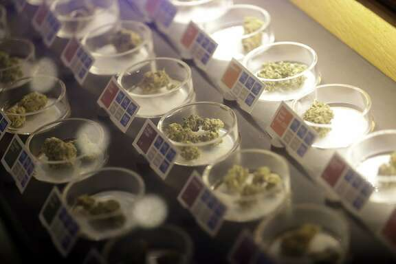Different types of marijuana are displayed at Sparc Dispensary Tuesday, Nov. 8, 2016, in San Francisco. California voters approved a ballot measure Tuesday allowing recreational marijuana in the nation's most populous state. (AP Photo/Marcio Jose Sanchez)