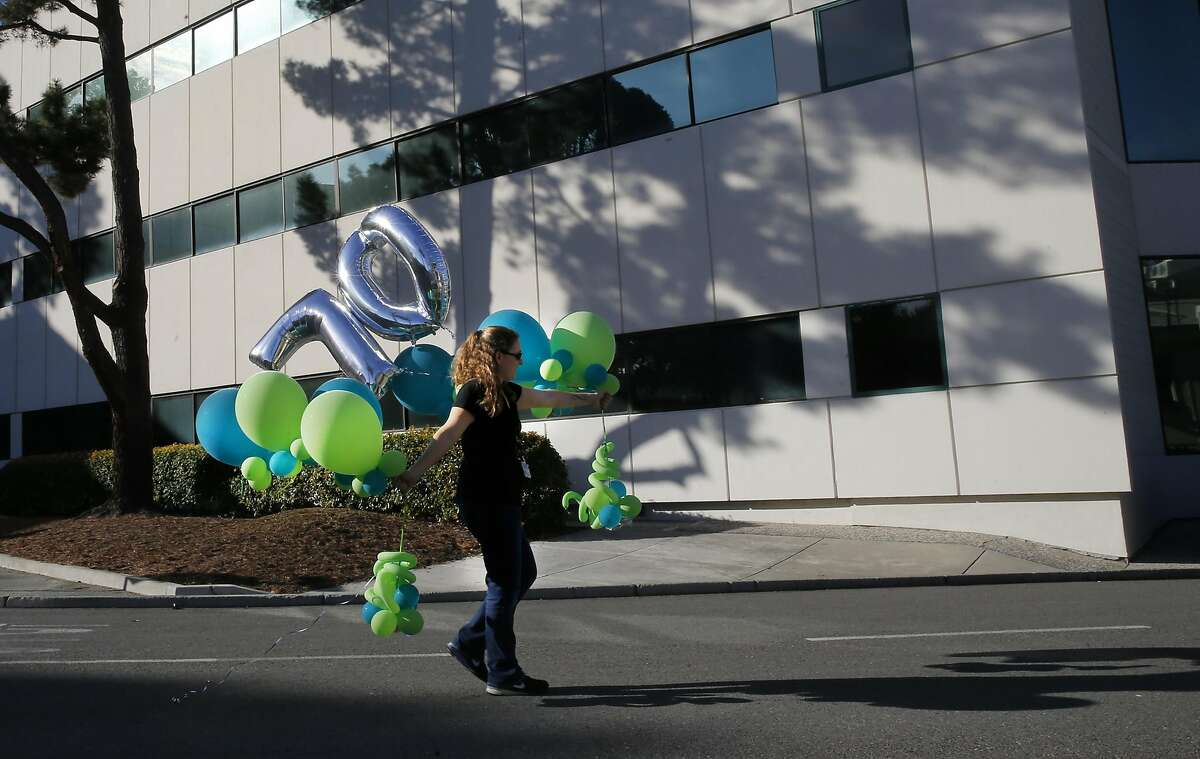 Kerri Carder-McCoy carries balloons through the campus where festivities have been going on all week to celebrate the company's 70th anniversary, at the headquarters of SRI International in Menlo Park, California, on Wednesday November 9, 2016