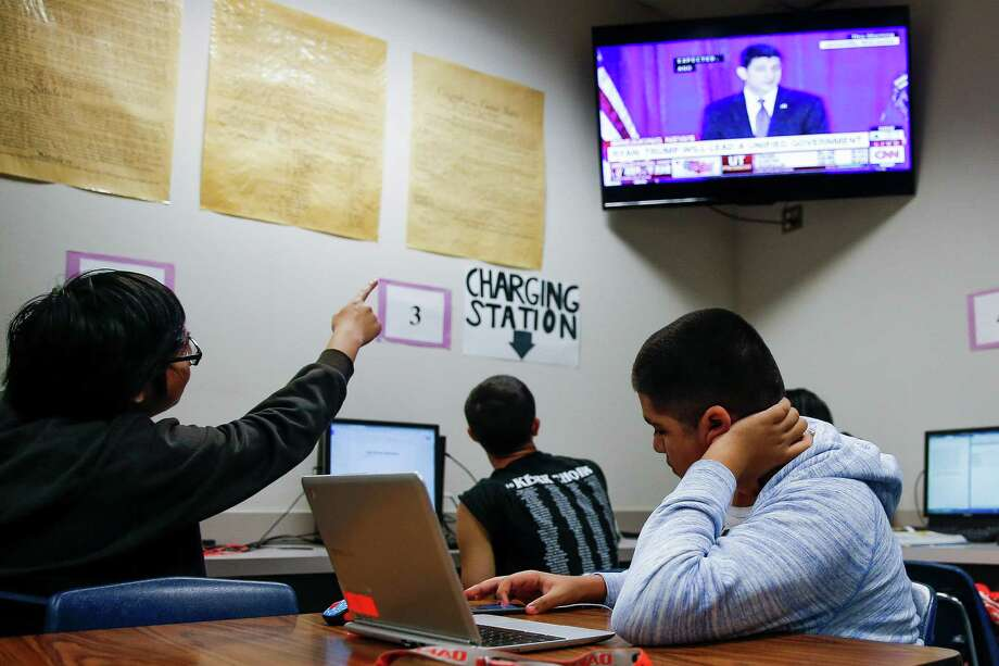 Kerr High School students watch election results in their world history class Wednesday. Photo: Michael Ciaglo, Staff / © 2016  Houston Chronicle