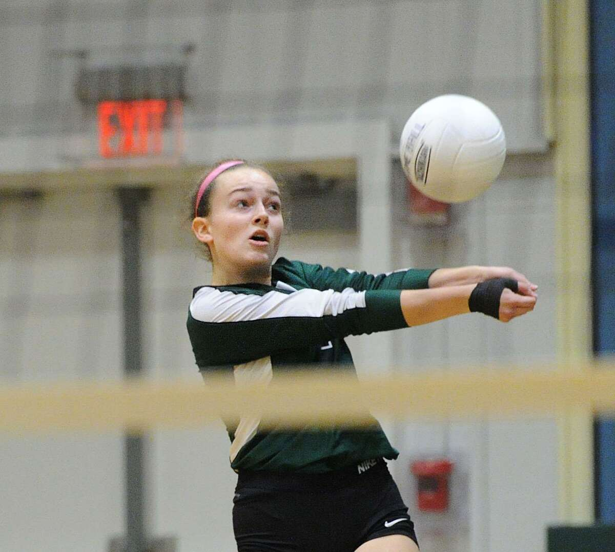 Ellie McKenney (7) of Sacred Heart returns a shot during the girls high school FAA semi-final volleyball playoff match between Sacred Heart Greenwich and School of the Holy Child at Sacred Heart in Greenwich, Conn., Wednesday, Nov. 9. 2016. Sacred Heart beat Holy Child 3-0 to advance to the final.