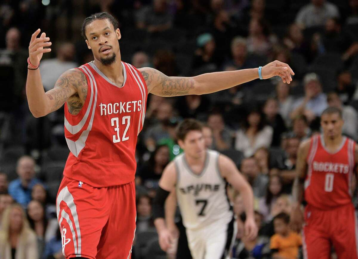 Houston Rockets guard K.J. McDaniels reacts after making a 3 point basket during the second half of a preseason NBA basketball game against the San Antonio Spurs, Friday, Oct. 21, 2016, in San Antonio. San Antonio won 114-99. San Antonio won 114-99. (AP Photo/Darren Abate)