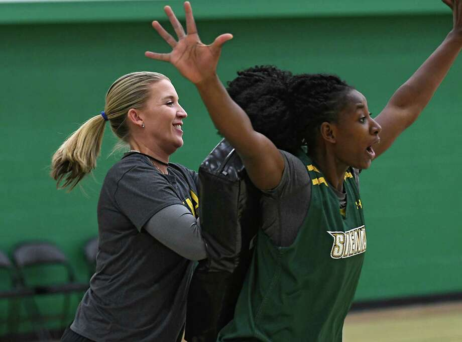Siena women's basketball coach Ali Jaques, left, participates in a drill during practice at Siena College on Tuesday, Nov. 8, 2016 in Loudonville, N.Y. (Lori Van Buren / Times Union) Photo: Lori Van Buren / 20038725A
