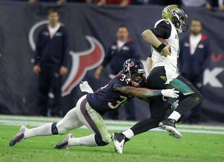 Former teammates at Central Florida, the Texans' A.J. Bouye, left, has had a chance to catch up with the Jaguars' Blake Bortles in the NFL. Photo: Brett Coomer, Staff / © 2014  Houston Chronicle