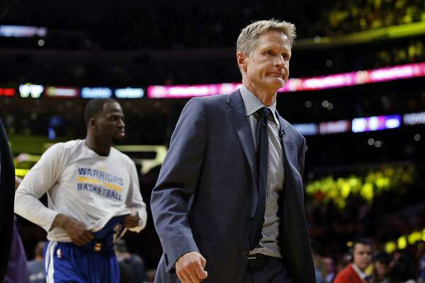 Golden State Warriors head coach Steve Kerr, right, and forward Andre Iguodala, left, walk off the court after the Los Angeles Lakers won 117-97 in an NBA basketball game in Los Angeles, Friday, Nov. 4, 2016. (AP Photo/Alex Gallardo)