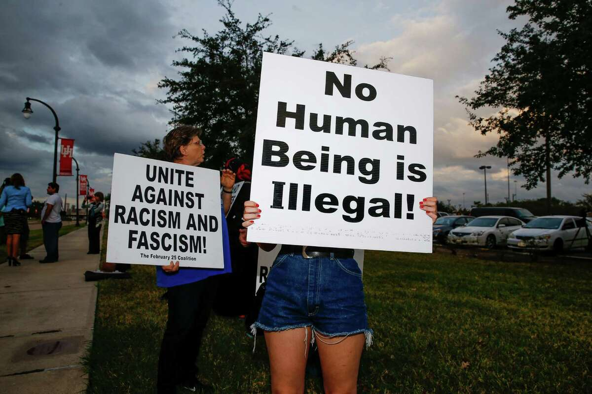 Savannah Guzman joins activists at UH on Wednesday as they protest the election of Donald Trump as president.