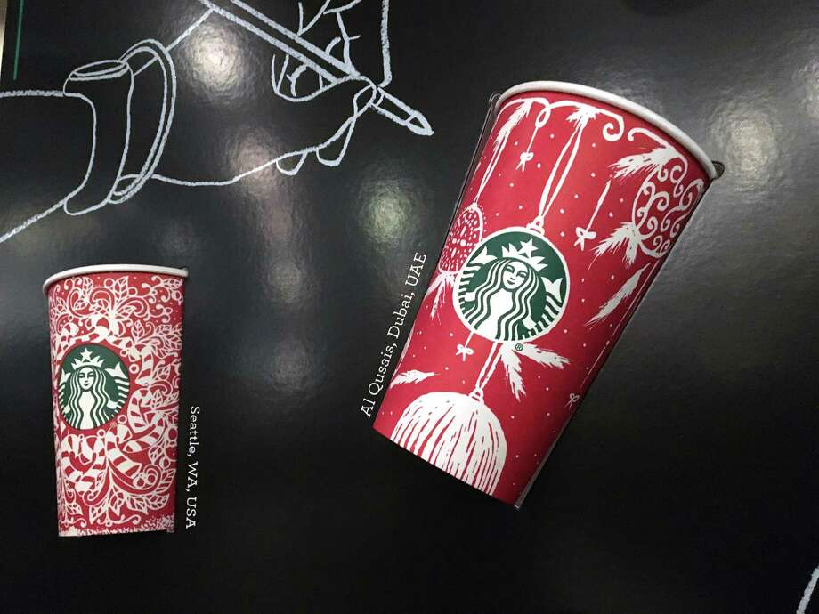 Starbucks holiday cups are on display Wednesday at a store in New York. Snowflakes, reindeer and candy canes are back on the retailer's cups. Photo: Joseph Pisani, STF / AP