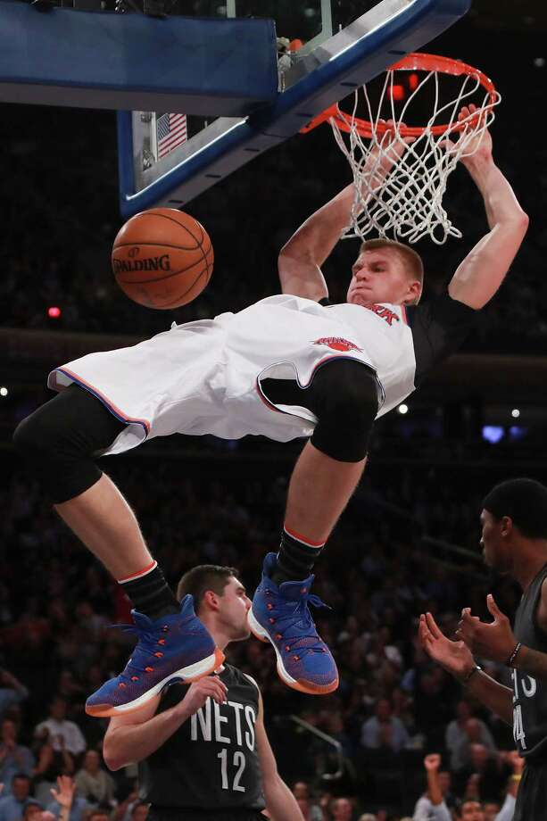 NEW YORK, NY - NOVEMBER 09:  Kristaps Porzingis #6 of the New York Knicks dunks against the Brooklyn Nets during the second half at Madison Square Garden on November 9, 2016 in New York City. NOTE TO USER: User expressly acknowledges and agrees that, by downloading and or using this photograph, User is consenting to the terms and conditions of the Getty Images License Agreement.  (Photo by Michael Reaves/Getty Images) ORG XMIT: 662352265 Photo: Michael Reaves / 2016 Getty Images