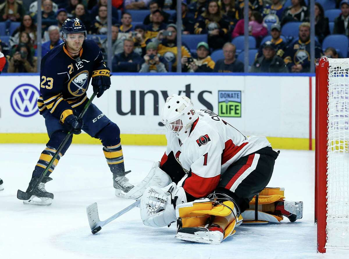 BUFFALO, NY - NOVEMBER 9: Mike Condon #1 of the Ottawa Senators stops a shot by Sam Reinhart #23 of the Buffalo Sabres during the overtime period at the KeyBank Center on November 9, 2016 in Buffalo, New York. Ottawa beat Buffalo 2-1 after a shootout. (Photo by Kevin Hoffman/Getty Images) ORG XMIT: 672869467