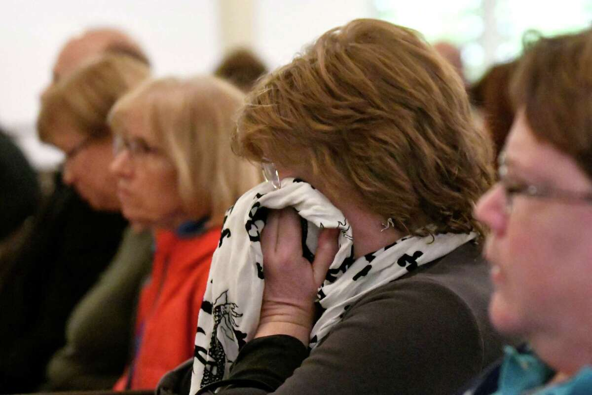 Carol Coogan, center, gets emotional during a community service to promote healing following a divisive election on Wednesday, Nov 9, 2016, at First Church of Albany in Albany, N.Y. (Cindy Schultz / Times Union)