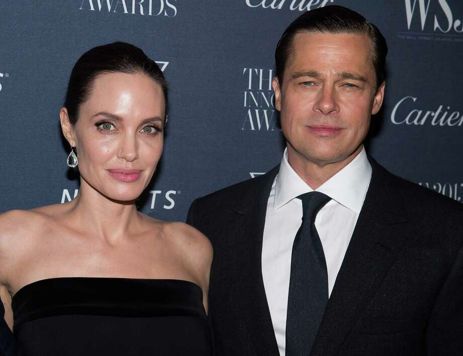 FILE - In this Nov. 4, 2015 file photo Angelina Jolie Pitt and Brad Pitt attend the WSJ Magazine Innovator Awards 2015 at The Museum of Modern Art in New York. Jolie has filed for divorce from Pitt, bringing an end to one of the world's most star-studded, tabloid-generating romances. (Photo by Charles Sykes/Invision/AP, File) ORG XMIT: LA101 Photo: Charles Sykes / Invision