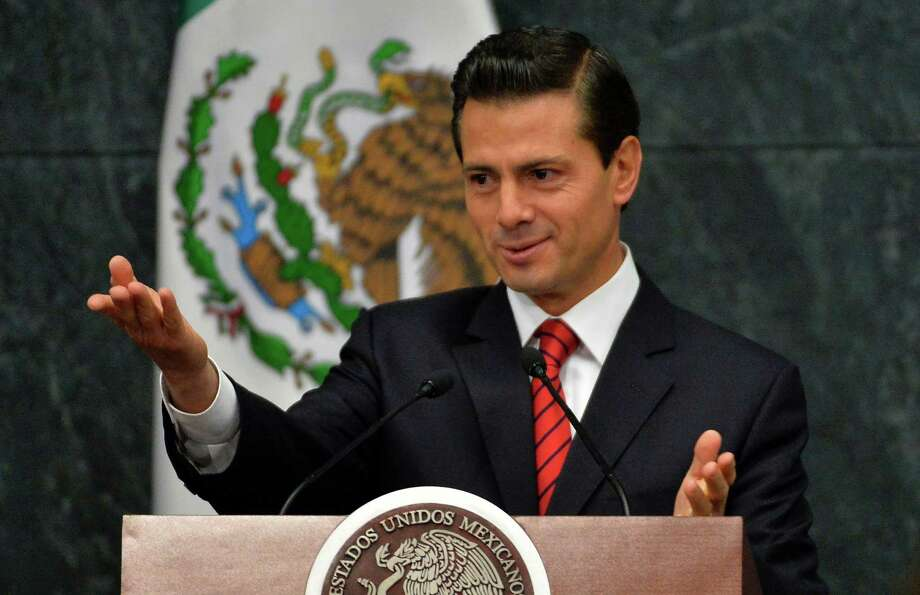 "Mexico's President Enrique Pena Nieto gestures as he delivers a message to the media about US presidential candidate Donald Trump's triumph at ""Los Pinos"" presidential residence on November 9, 2016 in Mexico City. / AFP PHOTO / PEDRO PARDOPEDRO PARDO/AFP/Getty Images ORG XMIT: 290 Photo: PEDRO PARDO / AFP or licensors"