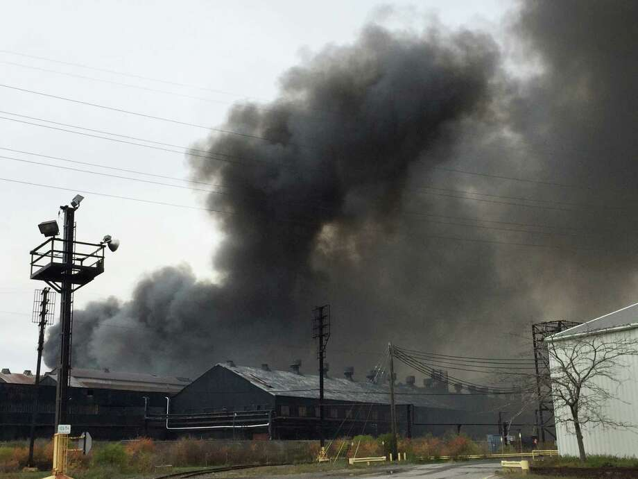 Smoke billows from the site ofa massive blaze at the former Bethlehem Steel Mill in Lackawanna, N.Y., on Wednesday, Nov. 9, 2016. The flames have since diminished, but smoke is visible for miles. No injuries were reported. (AP Photo/Carolyn Thompson) ORG XMIT: RPCT106 Photo: Carolyn Thompson / AP