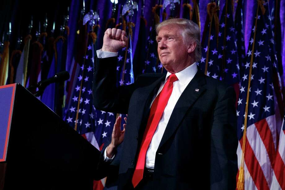 President-elect Donald Trump pumps his fist during an election night rally, Wednesday, Nov. 9, 2016, in New York. (AP Photo/ Evan Vucci) ORG XMIT: NYEV308 Photo: Evan Vucci / Copyright 2016 The Associated Press. All rights reserved.