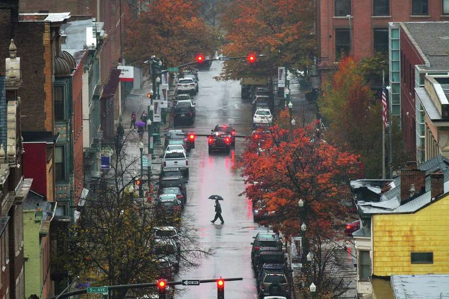 People make their way across Broadway as rain falls on Wednesday, Nov. 9, 2016, in Troy, N.Y.   (Paul Buckowski / Times Union) Photo: STAFF / 20038744A