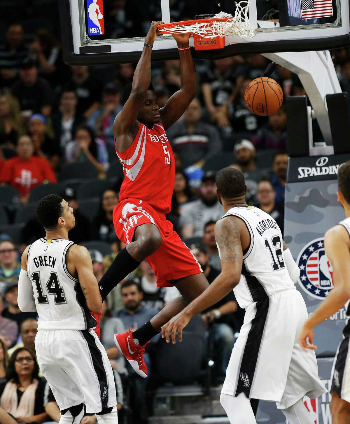 Houston Rockets' Montrezl Harrell (05) dunks over Spurs' Danny Green (14) and LaMarcus Aldridge (12) during their game at the AT&T Center on Wednesday, Nov. 9, 2016.