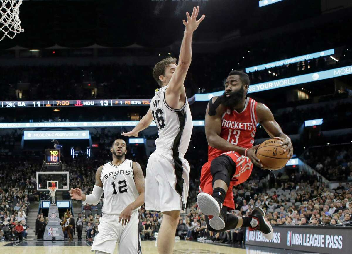 Houston Rockets guard James Harden (13) drives to the basket past San Antonio Spurs center Pau Gasol (16) during the first half of an NBA basketball game, Wednesday, Nov. 9, 2016, in San Antonio. (AP Photo/Eric Gay)